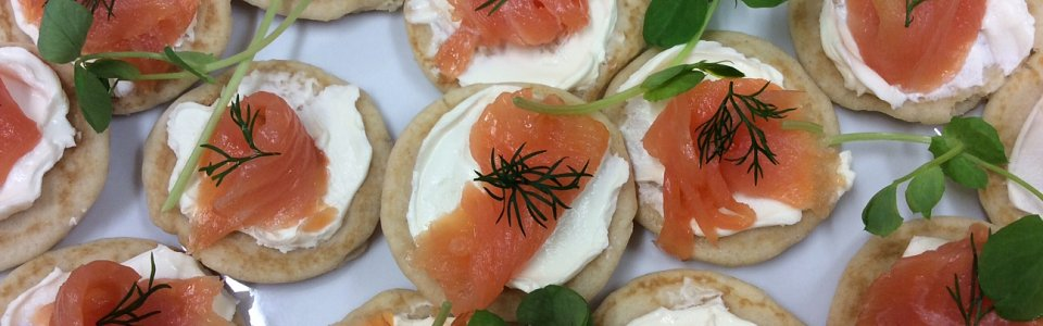 Smoked salmon and cream cheese on bilinis